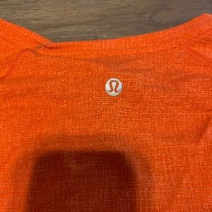 Orange Lululemon men's t shirt. Size M